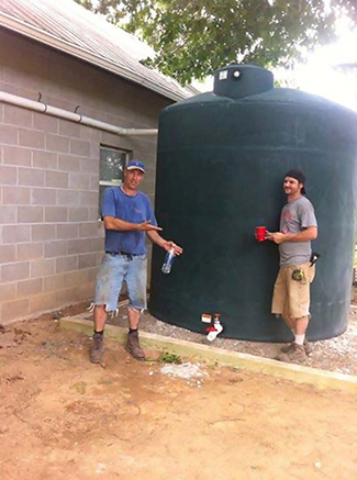 Newly installed cistern attached to farm building.