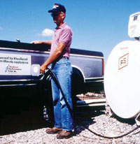 man filling truck with biodiesel