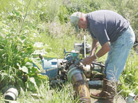 Man checking a pump
