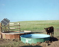 Solar-powered livestock watering system.
