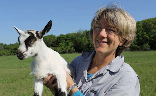 Photo of author with a small goat