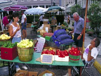 Vendors and customers at the Crescent City Farmers' Market in New Orleans, Louisiana.