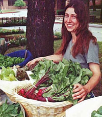 Katherine Kelly, owner of Full Circle Farm in Kansas City, sells her organic produce.